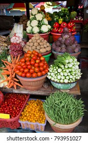 fruit and vegetables market with full counts pilled up in baskets for sale