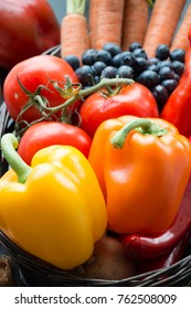 Fruit and Vegetables. Peppers, fruit and vegetables in a basket.