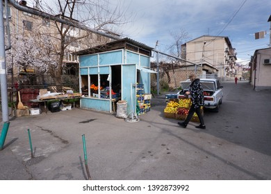 Fruit and vegetables street vendor, Yerevan, Armenia, March 2018: A man and his wife sale local fruits and vegetables from the boot of their Lada car in a side street of Shengavit District ion Yerevan