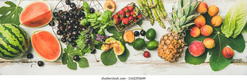 Fruit, vegetables. Summer food background. Flat-lay of seasonal fruit, vegetables and greens over white wooden background, top view. Vegetarian, vegan, dieting, clean eating, weight loss ingredients