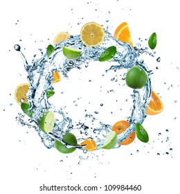 Fruit in water splash on white background