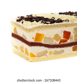 Fruit yogurt cheesecake on white background. Selective focus.