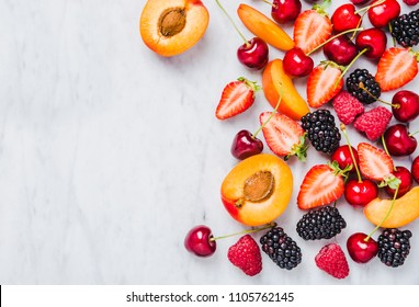 Fruits and berries copy space on marble table top view.