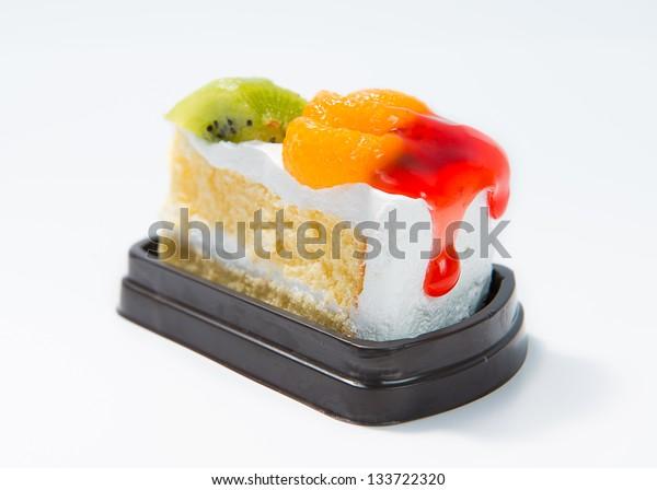 Fruits cake with orange and kiwi on top