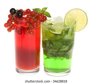 Fruits cocktails with berries and lime on white