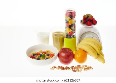 Fruits and green smoothies and kitchen scales