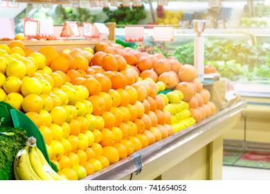 Fruits in grocery store. Oranges and mandarins in supermarket.