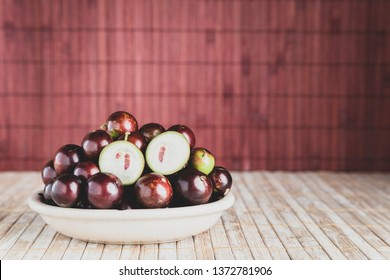 fruits of jaboticaba in bowl on the table, Plinia cauliflora