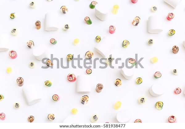 Fruits lollipops, happy new year. Candy, top view flat lay, handmade pattern on white background. Sweet sucker, lollipop, candy, isolated minimal concept above decoration, food background