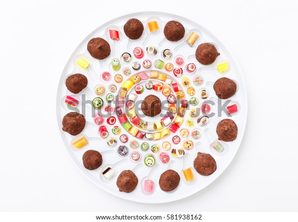 Fruits lollipops, heart and smile. Candy, top view flat lay, handmade pattern on white background. Sweet sucker, lollipop, candy, minimal concept above decoration. Chocolate Candy, Truffle