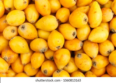 the fruits of loquat textured background, top view