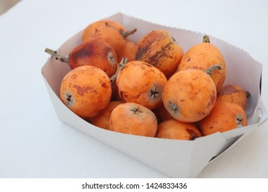 The fruits of the loquat are useful for health On a white background