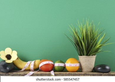 Fruits and measuring tape. Weight management and healthy life style concept.