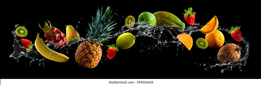 Fruits on black background with water splash - Shutterstock ID 594316418