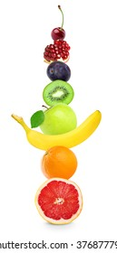 Fruits on white background. Healthy food concept. Stack of fresh color fruits