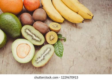 Fruits on a wooden background/toned photo