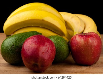 fruits on a wooden table,black background