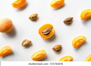 Fruits pattern. Apricot with kernel on white background.