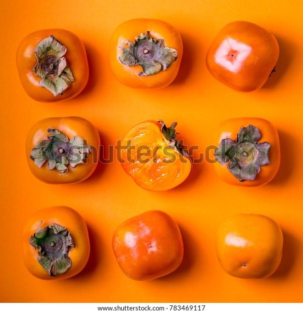 fruits persimmon at orange background