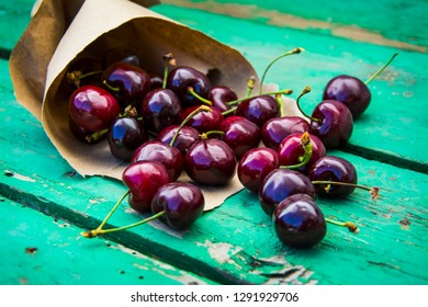 Fruits. Ripe sweet cherry in a paper package.