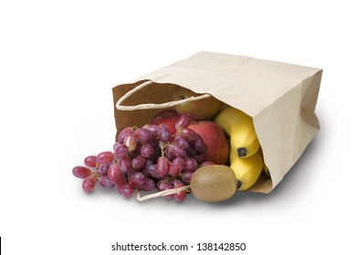 Fruits rolling out from the paper bag