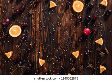 Fruits with spices and empty space for text  on wooden background