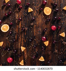 Fruits with spices on wooden background
