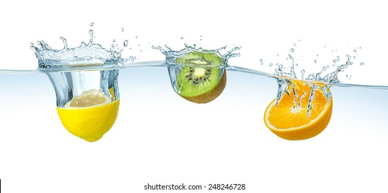 fruits splashing into the water