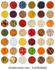 Fruits and vegetables berries spices herbs from above portrait format isolated on a white background