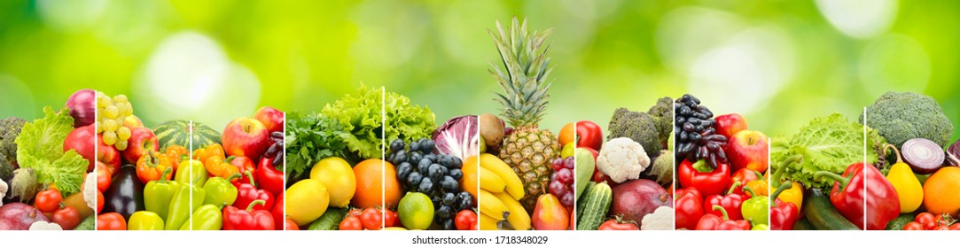 Fruits, vegetables and berry on green natural background.