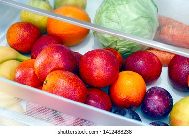 Fruits and vegetables in the fridge drawer. Close up.