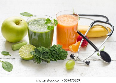 Fruits, vegetables, juice, smoothie and stethoscope health diet and fitness lifestyle concept