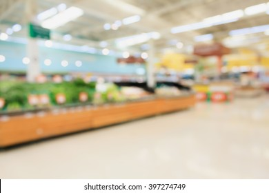 Fruits and vegetables on shelves in supermarket blur background