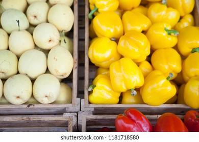 Fruits and vegetables on supermarket shelves