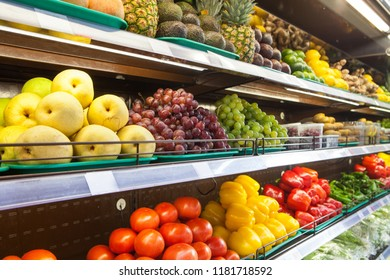 Fruits and vegetables on supermarket shelves