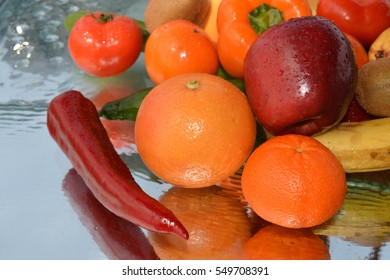 Fruits and vegetables on water background, tomato, cucumber