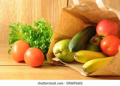 The fruits and vegetables in paper bag, shopping, diet and fitness concept