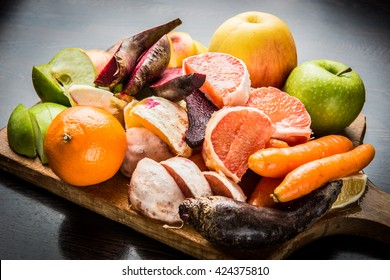 Fruits and vegetables for preparing heathy juice on wooden cutting board