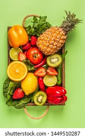 Fruits and vegetables rich in vitamin C in box. Healthy eating. Top view