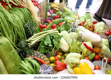 Fruits and vegetables are sold in the market.