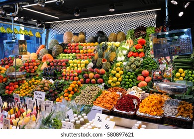 Fruits and vegetables stand in La Boqueria market, Barcelona, Spain