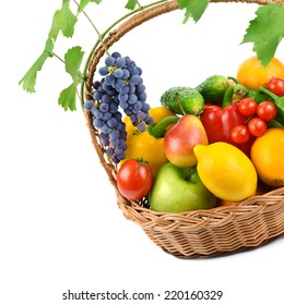 fruits and vegetables in a wicker basket isolated on white background