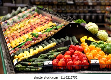 Fruits and vegitables displayed for sale in the produce department of a modern grocery store.