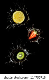 fruits in water lemon strawberry kiwi