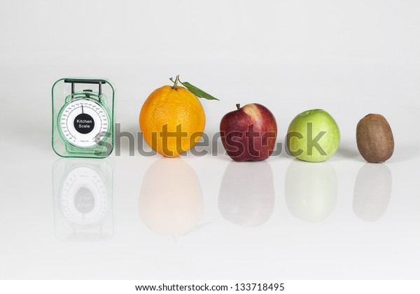 Fruits an weight scale isolated on white background