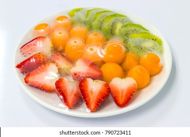 fruits which are wrapped with plastic film preservation on a table.