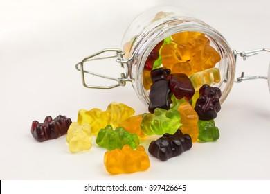 fruity gummy bears in a glass jar