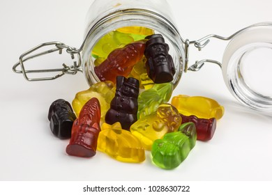 fruity gummy candy  christmas symbols in a glass jar