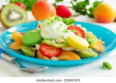 Fruity summer salad with meringue.