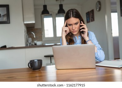 Frustrated annoyed woman confused by computer problem and talking on phone